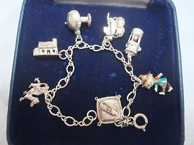 VINTAGE SILVER CHARM BRACELET - Bracelet with seven charms some opening