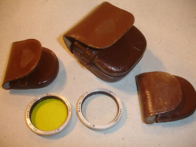 Rollei filters in leather cases, for TLR Rollei etc