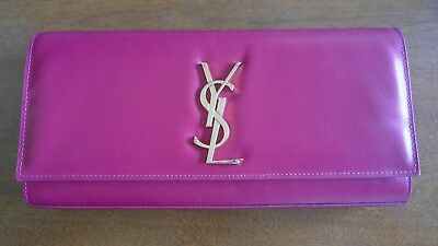 Used saint laurent ysl clutch fushia color in great condition