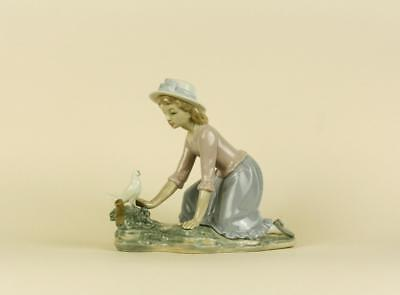 An Porcelain Lladro Nao Figurine of a Girl with Bird.