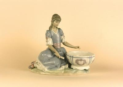 A Large Exquisite Lladro figurine of Young Girl with a Bowl.