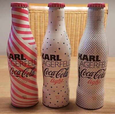 Nice coca cola karl lagerfeld alu bottle set from germany. All full. Not perfect