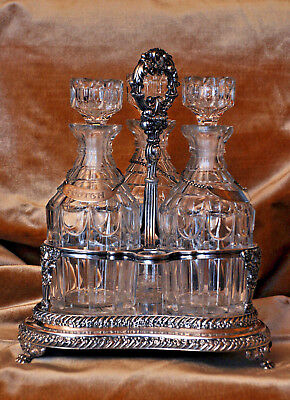 Antique Silver Plate Tantalus with 3 Pillar Cut Decanters  Circa 1850's