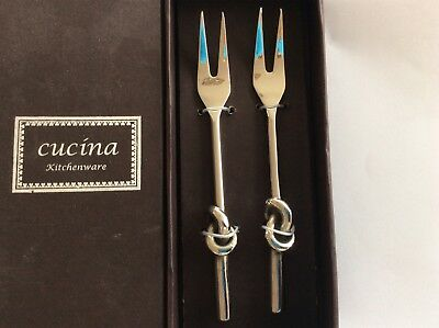Two boxed Pickle Forks
