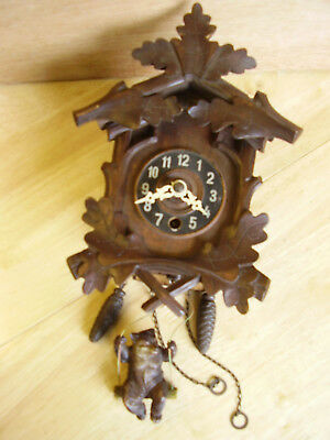 Cuckoo style clock with bouncing bear.Spares/Repairs