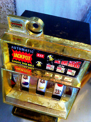 Toy slot machine, fruit machine in rugged condition but works,1970s