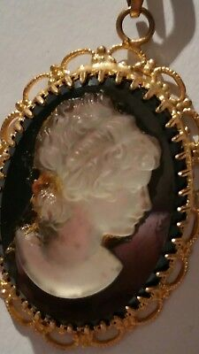 Vintage GLASS cameo pendant in filigree gold tone frame with gold tone chain.