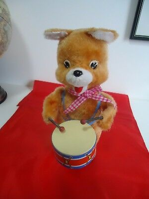 Battery operated teddy the drumming bear