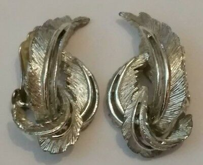 Vintage 70s heavy chunky silver tone clip on earings by Sarah Coventry.