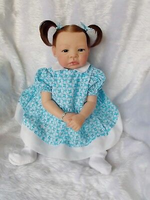 Dark brown haired, dark blue/green eyed, 22 in older reborn baby girl, Ava.