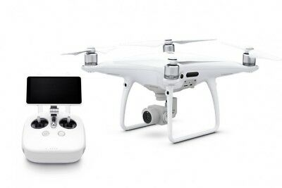 DJI Phantom 4 Quadcopter Drone with 2 additional batteries and charger