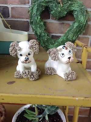 vintage ceramic spaghetti dog puppies with fly on nose and head
