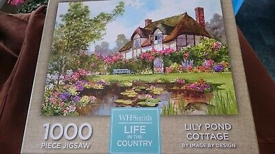 WH Smith 'Lily pond cottage' 1000 piece jigsaw puzzle. Very good used condition