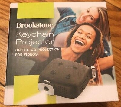 New in Box ! Brookstone Keychain Mini Portable Projector Black