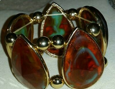 Vintage 1970s chunky faceted acrylic stretch bracelet.  Costume jewellery.