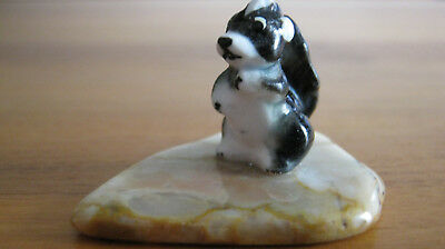 Tiny Porcelain Skunk Figurine Mounted on a Polished Slice of Agate
