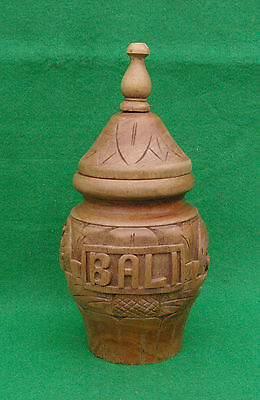 A  Decorately Turned And Carved Wooden Pot With Lid From Bali Stained And Waxed