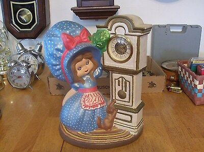 Very Colorful Girl And Cat Next To Grandfather Clock. Wind Up (Germany)