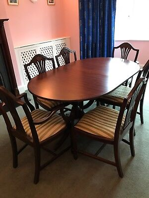 Mahogany Stag Minstrel dining table, six chairs and sideboard (optional)