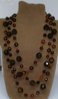 Vintage 1970s long faceted lucite crystal beaded necklace. Root beer.