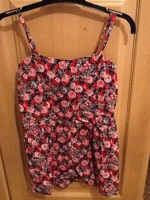 Girls New Look red ,pink & black floral playsuit. age 8 years