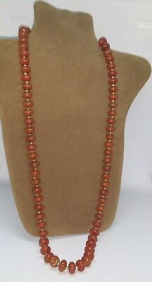 Vintage 1970s lucite beaded necklace with gold tone spacer beads.  Costume jewel