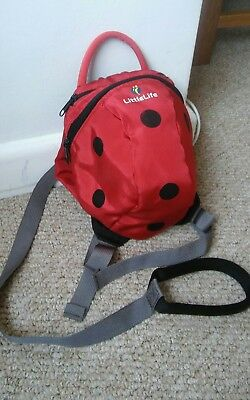 Littlelife backpack with reins. Ladybird image. Good condition