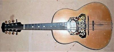 Mandolin  / guitar 8 strings needs repair to belly and new strings