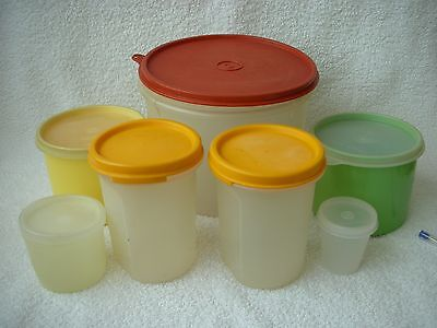 7 ASSORTED SIZES CYLINDRICAL CONTAINERS all with LIDS