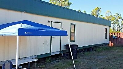 24 by 64ft doublewide  office mobile home as is Samsula fl