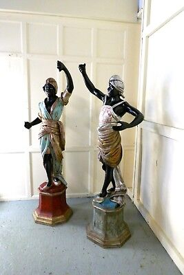 A Life size Pair of Italian Carved Wooden Blackamoors or Nubians