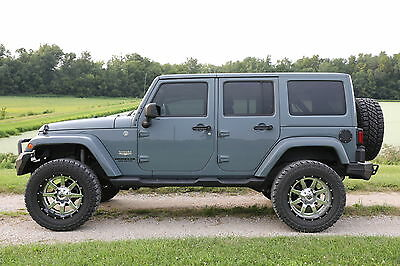 2014 Jeep Wrangler  2014 Jeep Sahara Unlimited, Lifted, New Top, Tons of Extras, Low Miles, AWESOME