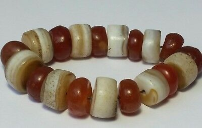 A Beautiful Strand Of 19 Ancient Indo-Tibetan Agate & Carnelian Disk Beads