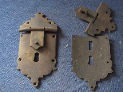 2 brass shield shape escutcheons with lid fittings