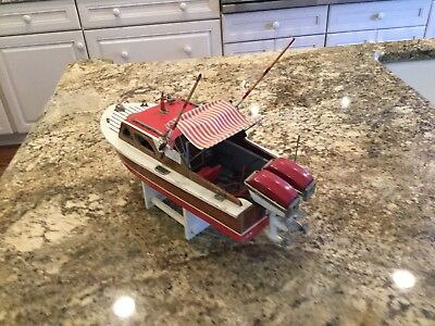 Vintage Antique Toy Wooden Boat, red and in great condition. It's 14 inches long