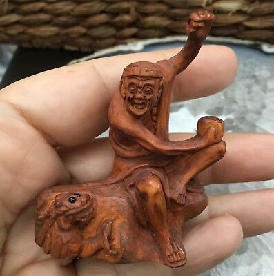 Netsuke.  Seated Old Man or Beggar and Creeping Dragon Boxwood Netsuke.