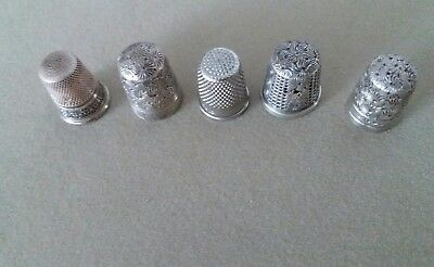 five Vintage thimbles 2 silver 3 others