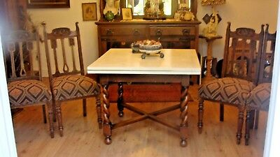Arts and Craft period oak tulip chairs fully reupholstered
