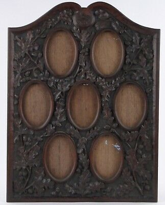 A Victorian Relief Carved Hardwood Frame For Holding 7 Oval Miniature Paintings
