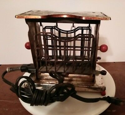 ANTIQUE TORRID 1920's button toaster W/ swing out bread holders, with cord