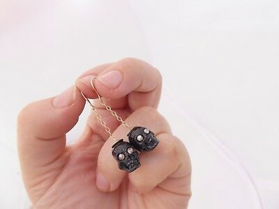9ct/9k gold Diamond eyed black enamel momento mori skull drop earrings, 375