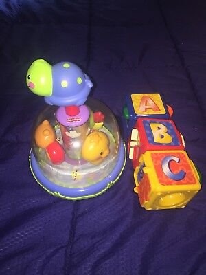2 x FISHER PRICE BABY TOYS - PUSHDOWN SPINNING TOY & STACKING ACTION BLOCKS