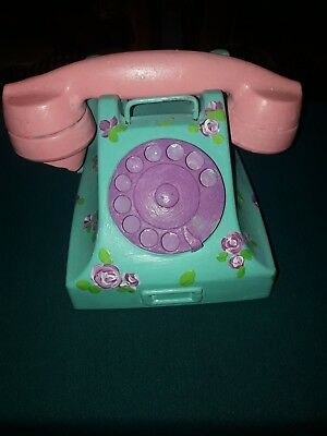 not working old telephone as antique at 1980s with hand colourful painting draw