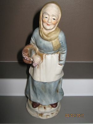 Ceramic figurine no5 old woman standing with basket 140 to 180 mm ex/cond