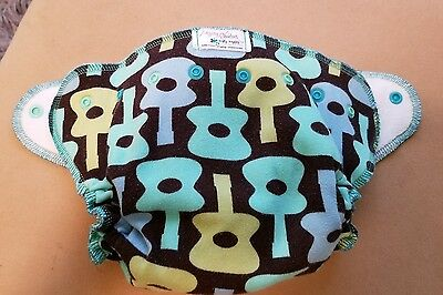 Nifty Nappy One Size All in 2 diaper.  Guitar print with bamboo insert