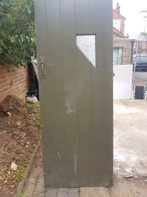 Old latched and ledged Outside toilet door