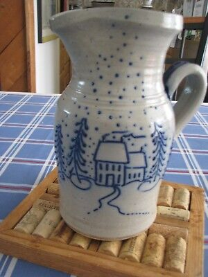 Pitcher with a winter scene by Eldreth Pottery