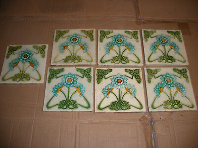 Original Victorian or art nouveau floral fireplace tiles. Set of 7