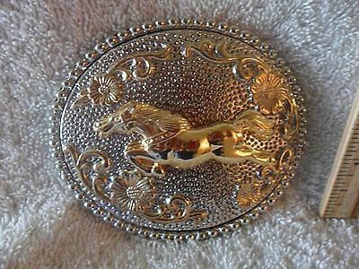 Western Horse Jumping Gold color on Silver color background Belt Buckle NWT