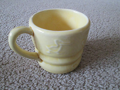 Vintage Yellow Child's Pottery Mug With Embossed Animal Outlines Baby Cup Cal
